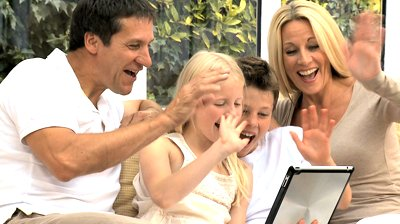 stock-footage-caucasian-family-using-wireless-tablet-for-online-video-chat