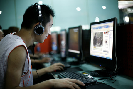"In this photo taken Tuesday, June 20, 2009, customers surf the Internet at an Internet cafe in Beijing, China. In a rare reversal, China's government gave in to domestic and international pressure and backed down from a rule that would have required personal computers sold in the country to have Internet-filtering software. Just hours before the rule was to have taken effect Wednesday, the government said it would postpone the requirement for the ""Green Dam"" software.  (AP Photo/Greg Baker)"