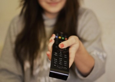 woman-girl-remote-watching-large