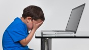 Boy in front of laptop.