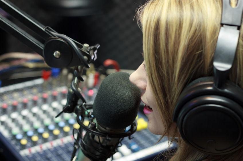 32287744 - beautiful woman working as radio dj live in studio
